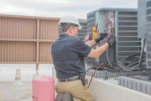HVAC Service Guy Fixing